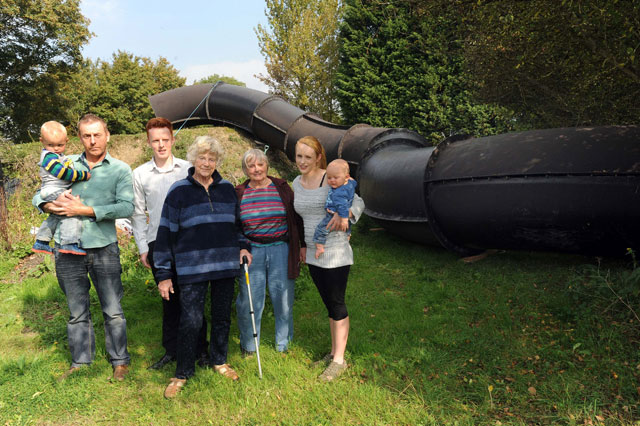 Dad builds 135ft monster waterslide in back garden