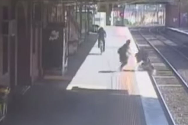 Toddler in pram falls onto train tracks