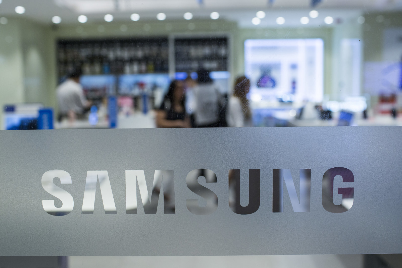 Signage is displayed on a window at a Samsung Electronics Co. Partnershop retail store in Hong Kong, China, on Tuesday, Oct. 11, 2016. Samsung Electronics Co. is ending production of its problematic Galaxy Note 7 smartphones, taking the drastic step of killing off a smartphone that became a major headache for South Koreas largest company. Photographer: Justin Chin/Bloomberg via Getty Images