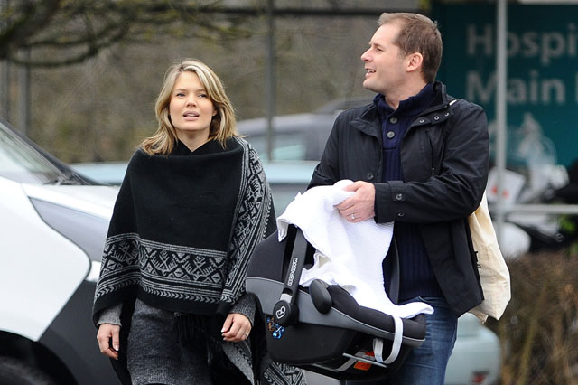 Charlotte Hawkins leaves hospital with her newborn daughter