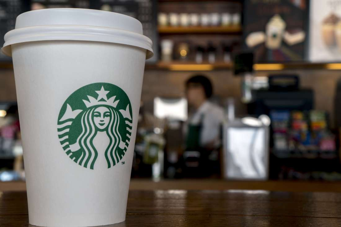 WEIFANG, SHANDONG PROVINCE, CHINA - 2016/08/31: Paper cup in a Starbucks coffee shop.  During the third quarter 2016, Starbucks China had $768.2 million in sales, a growth of 17% compared to the prior period. (Photo by Zhang Peng/LightRocket via Getty Images)