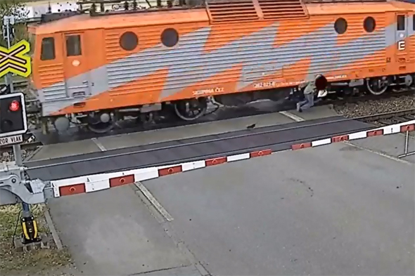 Pensioner hit by train - but gets up and walks off (video)