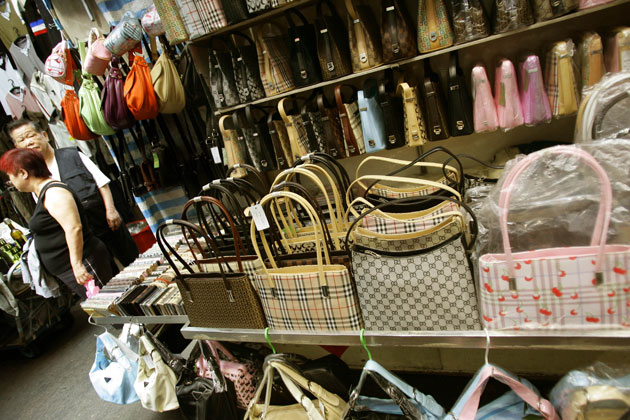 Luxury brands sue Chinese online shopping giant for allowing fakes