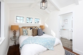 bedroom with mixed and matched prints