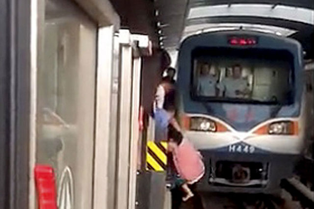 Pregnant woman falls onto train tracks and under oncoming train