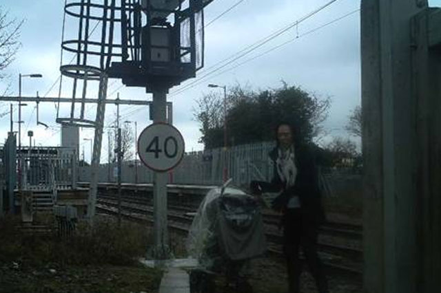 Mum walks toddler and baby across LIVE railway tracks
