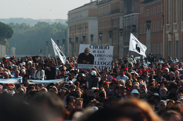 Amid the crowd in St. Peter's Square in 2005, Calabrians faithful to St. Gaetano wave a flag and signs with his image.