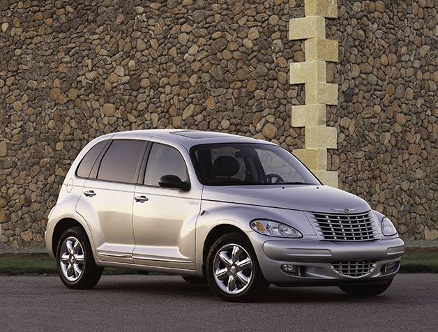 2002 Chrysler PT Cruiser with rock wall