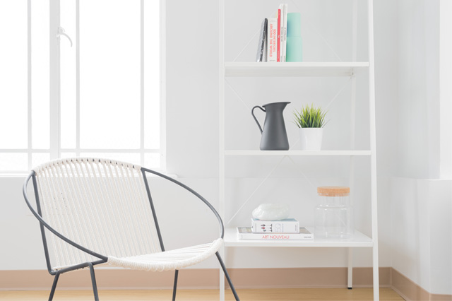 chair and ladder shelf in room