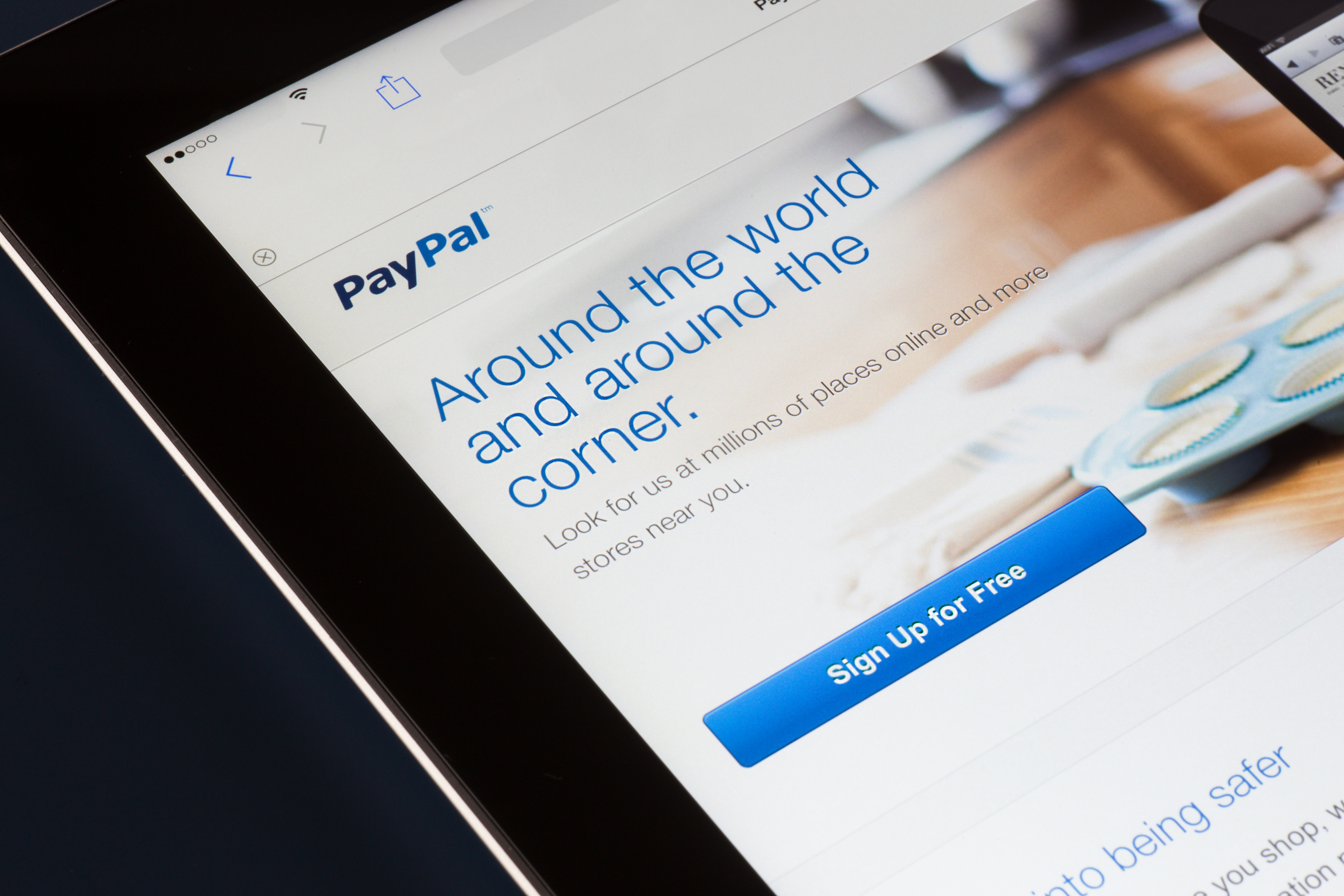 NEW YORK CITY - FEB. 3, 2014:  Paypal website displayed on tablet screen against dark background.  Established in 1999, PayPal a