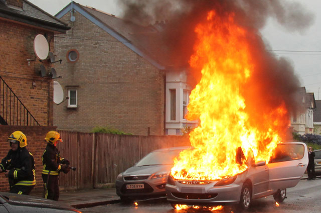 Baby saved from burning car moments before it exploded