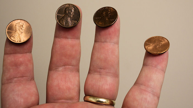 Balancing pennies on fingers