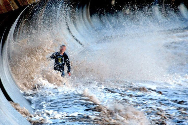 Boy almost washed out to sea as he walks through waves