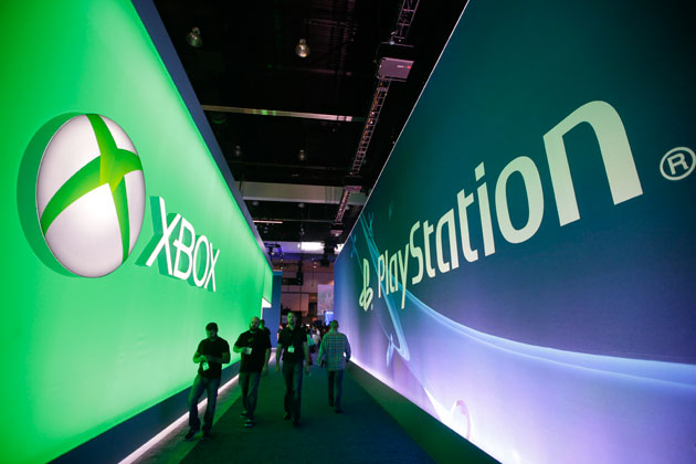 The Xbox and PlayStation booths at E3 2014