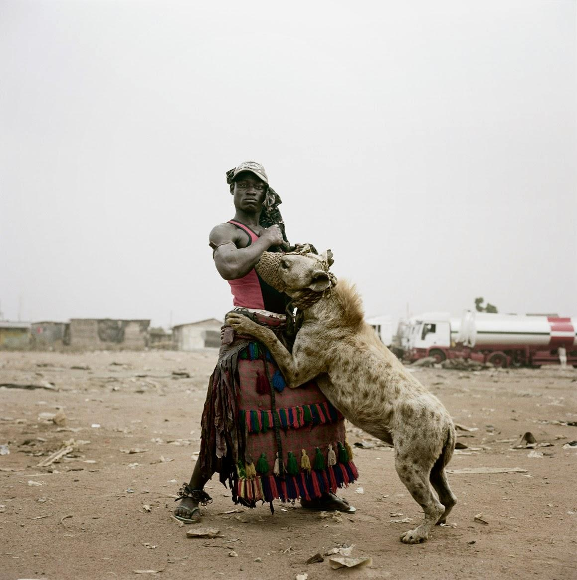 manliest photos on the internet, funny manly images, nigerian man playing with hyena