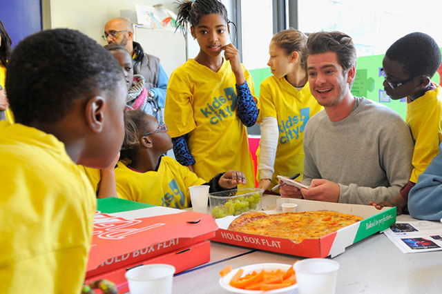 Spider-Man star Andrew Garfield with children in South London