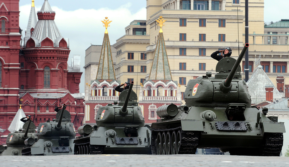 Russian WWII-era T-34 tanks drive through Red Square during a Victory Day parade rehearsal in Moscow on May 6, 2010. Russia will mark the 65th anniversary of Allied forces' victory over the Hitler coalition in WWII on May 9. Troops from four NATO states will march through Red Square for the first time as Russia marks the 65th anniversary of the World War II victory with its biggest parade since the Soviet collapse.  AFP PHOTO /  ALEXANDER NEMENOV (Photo credit should read ALEXANDER NEMENOV/ AFP/ Getty Images)(Photo Credit should Read / AFP/ Getty Images)