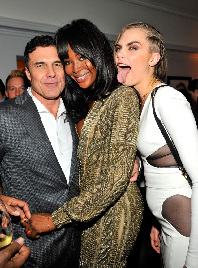 Cara Delevingne photobombs a stunning Naomi Campbell at pre-Golden Globes party