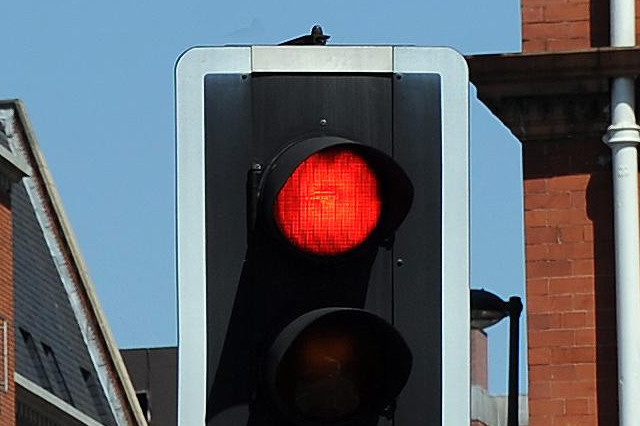 A view of a traffic junction in Leeds city centre, where a thrush has built its nest inside a traffic light (centre).