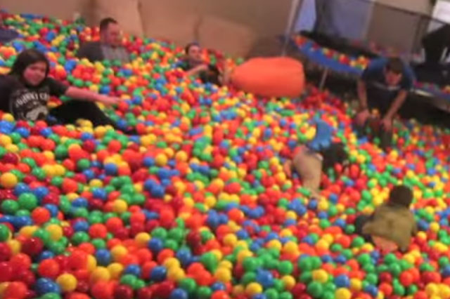 Dad turns lounge into giant ball pit - much to his kids' delight (and his wife's amazement!)