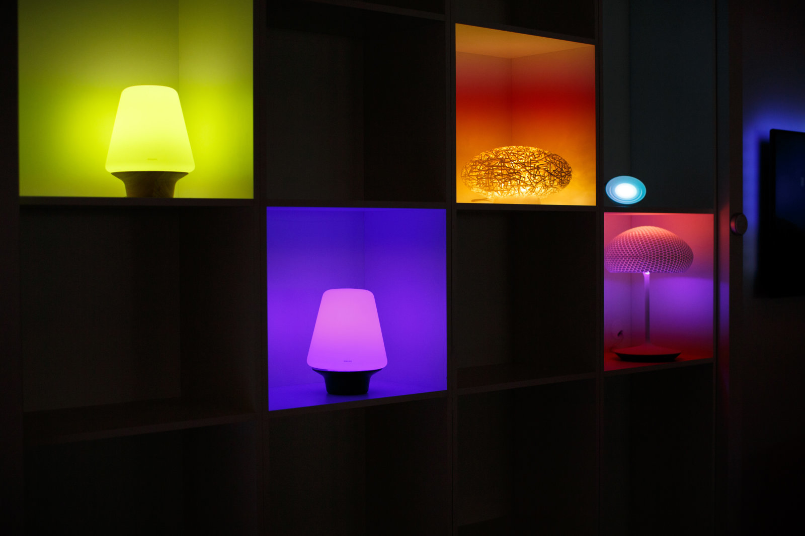 Philips hue personal wireless lights, manufactured by Royal Philips NV, sit illuminated during the company's annual general meeting in Amsterdam, Netherlands, on Thursday, May 1, 2014. Philips is focusing on higher-margin areas such as lighting products that save energy, and health and wellness offerings, to move away from its consumer-electronics past amid competition from Asian rivals such as Samsung Electronics Co. and Sony Corp. Photographer: Jasper Juinen/Bloomberg via Getty Images