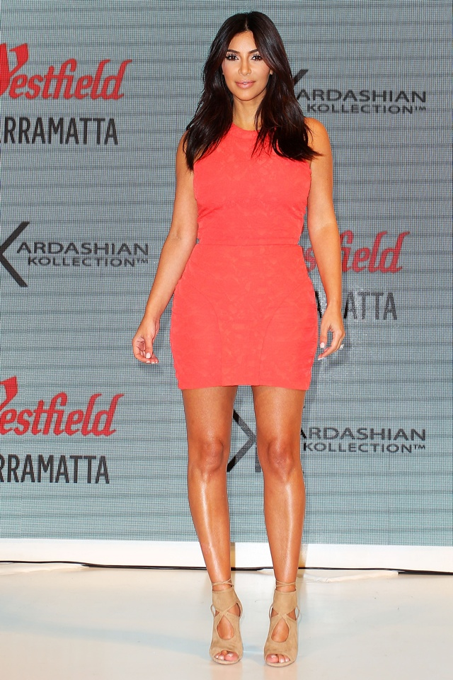 Kim Kardashian does orange minidress for Sydney appearance