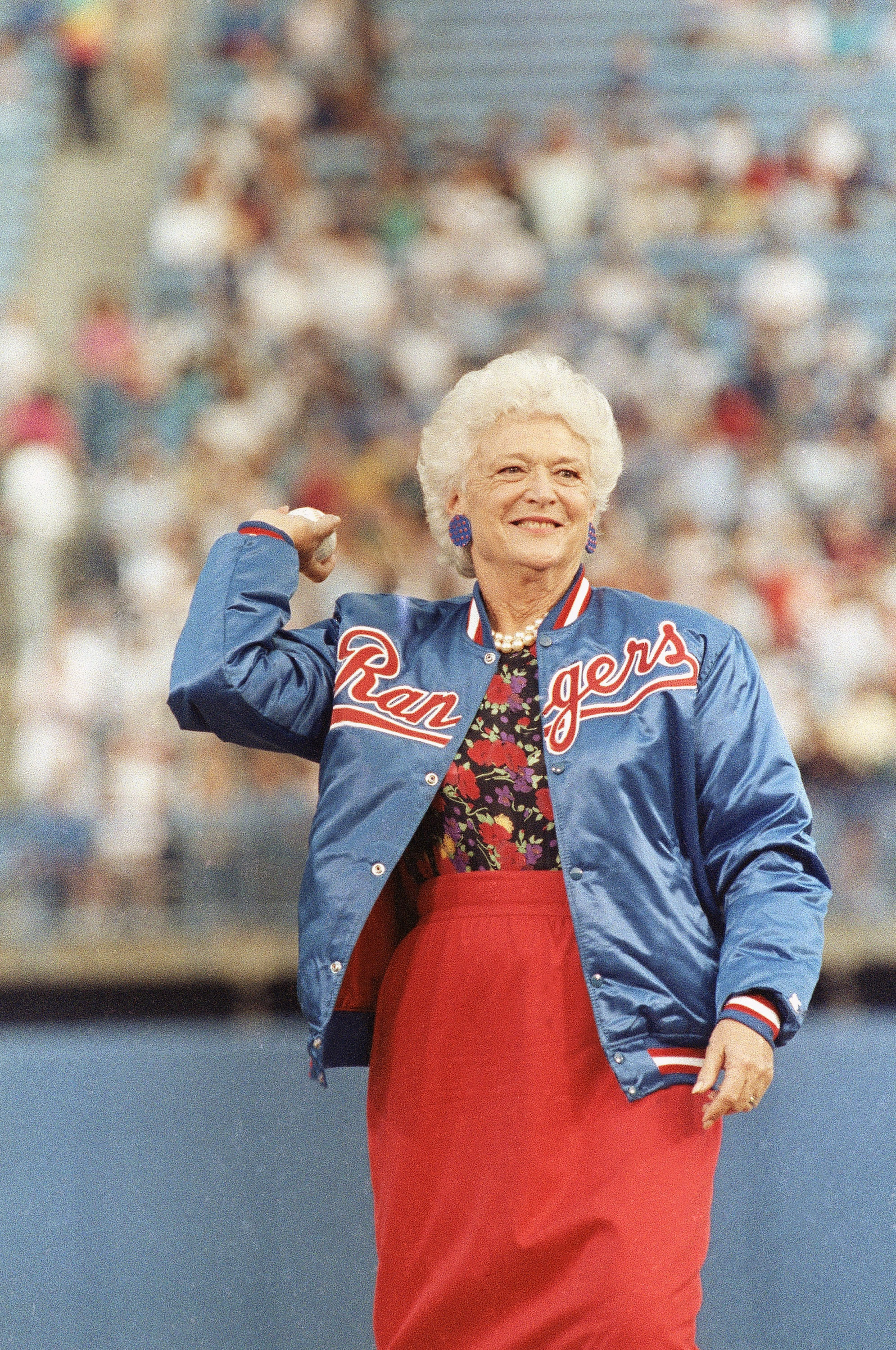 First lady Barbara Bush throws out the first pitch before the start of the Texas Rangers game against the New York Yankees in Arlington, Texas, May 5, 1989. Mrs. Bush's son, George W. Bush, is an owner of the Texas Rangers. (AP Photo/Bill Janscha)