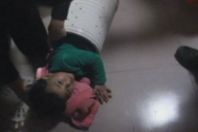 Toddler stuck in washing machine for an hour cut free by fire fighters (video)