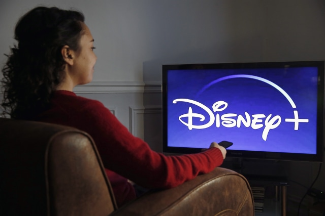PARIS, FRANCE - DECEMBER 26: In this photo illustration, the Disney + logo is displayed on the screen of a TV on December 26, 2019 in Paris, France. The Walt Disney Company launched its Disney + Streaming Service (Svod) in the United States on November 12, 2019. A month after its launch, Disney Plus has registered 24 million subscribers in the United States, which is very much higher than the forecasts and ambitions of the group, which targeted 20 million subscribers worldwide in 2020.  (Photo by Chesnot/Getty Images)