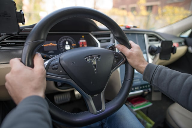 24 November 2019, Berlin: View of the steering wheel of a Tesla (Model S, year 2014). Photo: Jörg Carstensen/dpa (Photo by Jörg Carstensen/picture alliance via Getty Images)