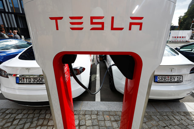 The company logo of Tesla cars is seen on the V3 supercharger equipment during the presentation of the new charge system in the EUREF campus in Berlin, Germany September 10, 2020. REUTERS/Michele Tantussi