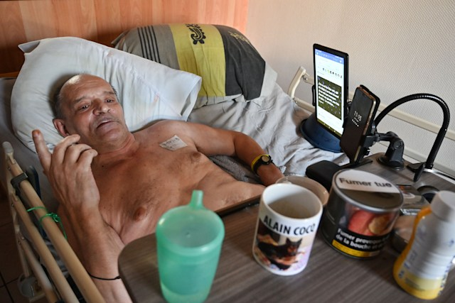 """Alain Cocq, suffering from an orphan desease of the blood, rests on his medical bed on August 12, 2020 in his flat in Dijon, northeastern France. - Alain Cocq appeals to the French President to receive the authorization from the medical profession to prescribe a barbiturate. """"I am not asking for assisted suicide or euthanasia,"""" he defends himself. """"But an ultimate care. Because I am just trying to avoid inhuman suffering"""", which the Leonetti law currently does not allow regarding the end of life, according to him. Alain has a telephone appointment on August 25, 2020 with the health advisor of the presidency, Anne-Marie Armanteras. (Photo by PHILIPPE DESMAZES / AFP) (Photo by PHILIPPE DESMAZES/AFP via Getty Images)"""