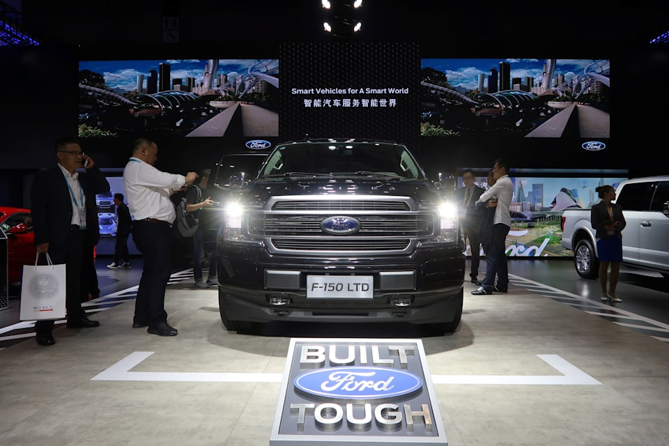 Visitors look at a Ford F-150 pickup displayed at the China International Import Fair (CIIE) in Shanghai, China November 6, 2019. Picture taken November 6, 2019.  REUTERS/Yilei Sun
