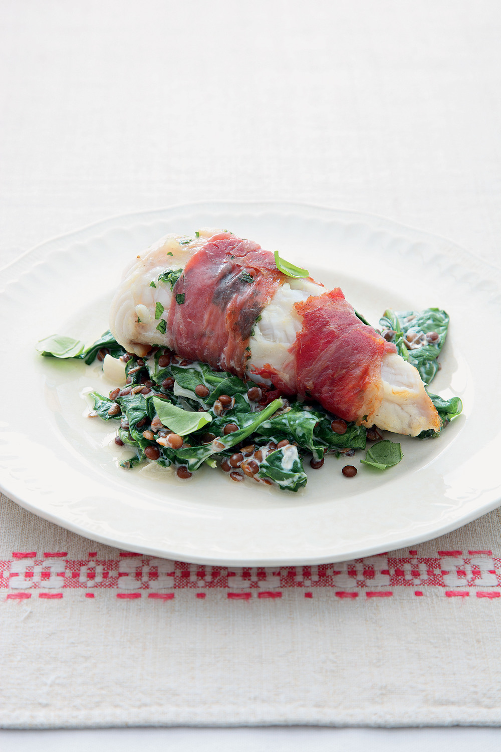 monkfish wrapped in prosciutto with lentils and spinach recipe