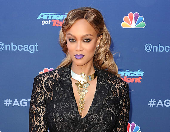Tyra Banks flashes undies in sheer suit