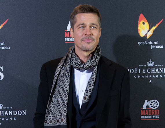Brad Pitt steps out in the rain