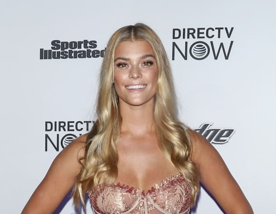 Nina Agdal hits SI Swimsuit party in nude gown