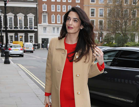Amal Clooney puts growing baby bump on display