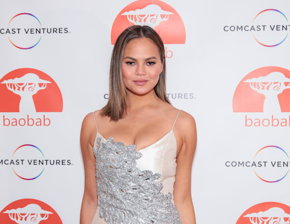 Chrissy Teigen is gorgeous in silver mini dress
