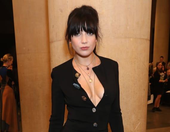 Daisy Lowe reveals breast in a low-cut dress