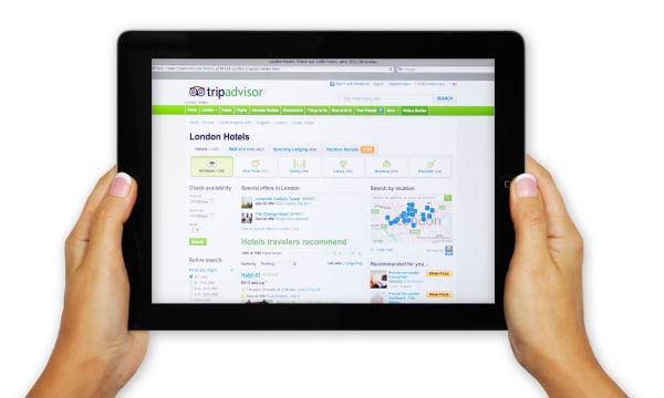 iPad screen showing Trip Advisor website - online hotel arrangements