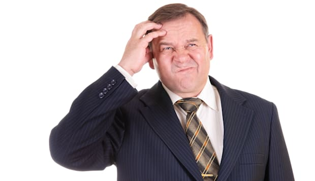 confused businessman with...