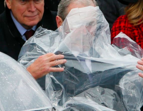Bush struggles with his poncho at inauguration