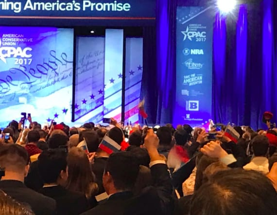 CPAC attendees wave Russian flags at Trump speech
