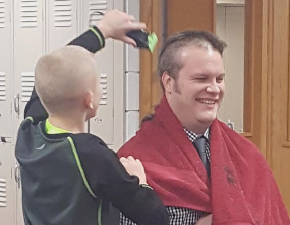 Principal shaves head for bullied 6th grader