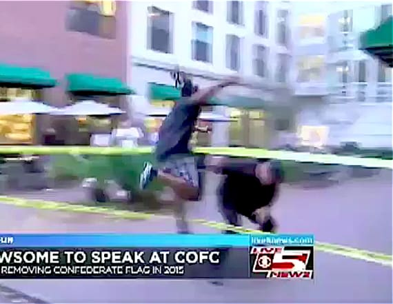 Man takes down Confederate flag on live TV