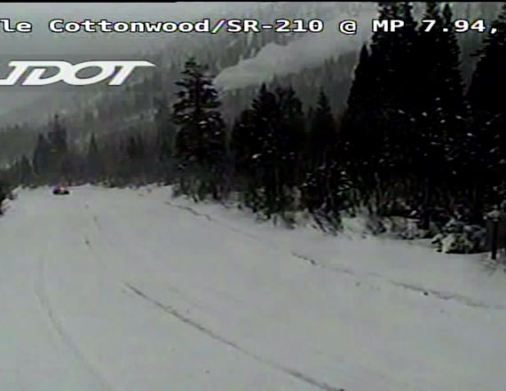 Traffic camera shows avalanche ripping across road