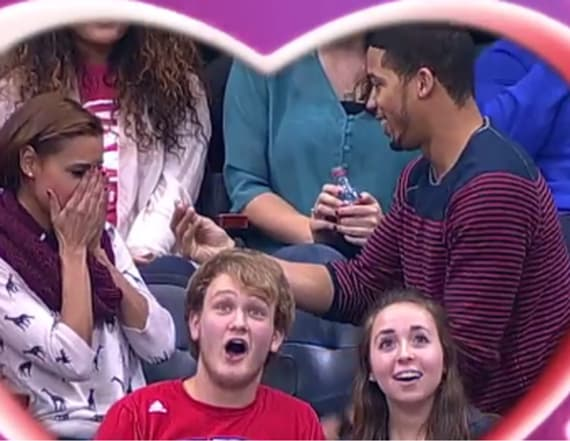 Man's kiss cam proposal goes horribly wrong