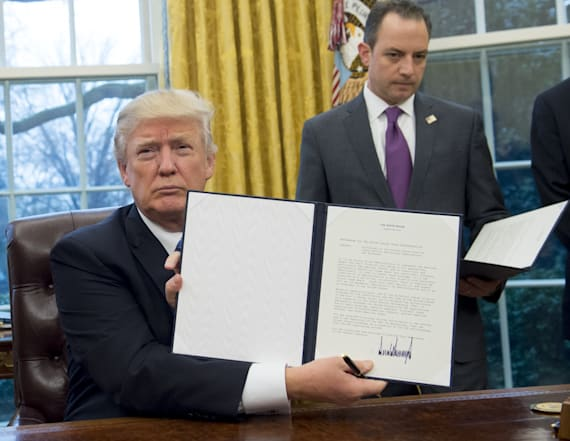 Trump signs order withdrawing US from TPP trade deal