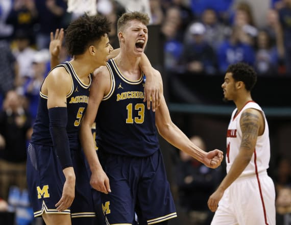 Michigan moves on with upset over Louisville